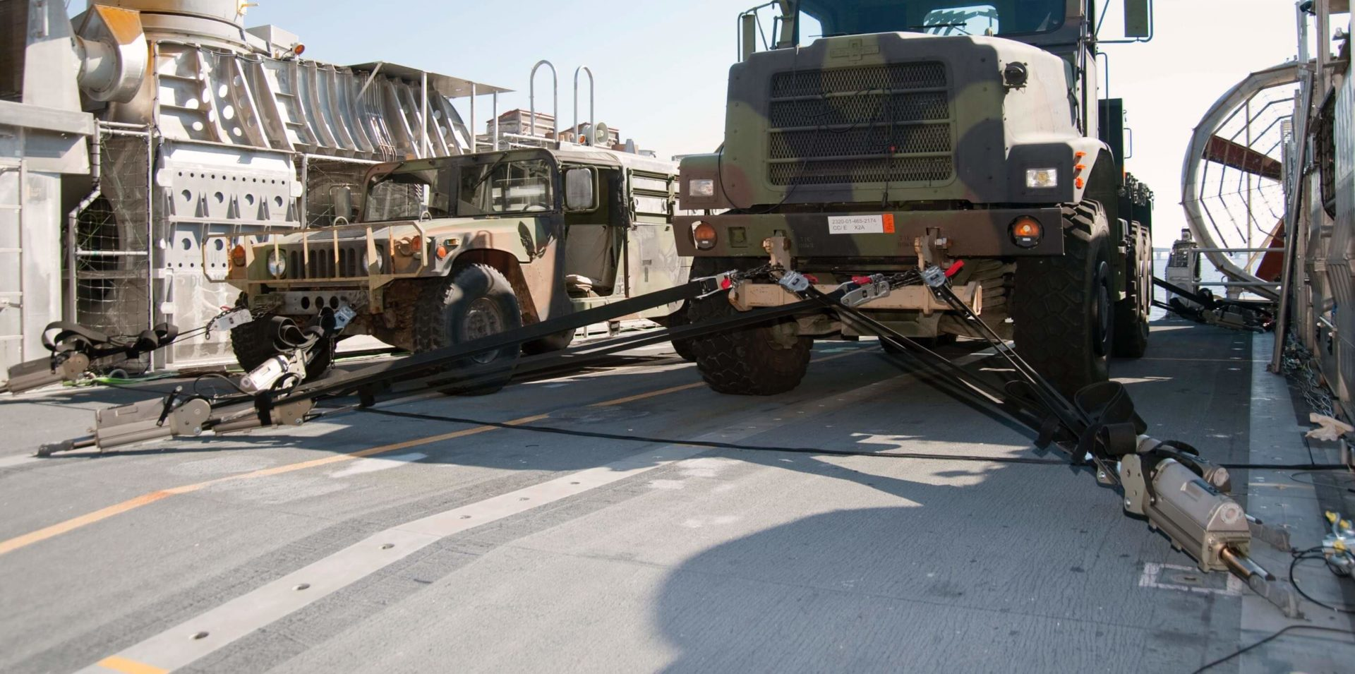 A military transport vehicle with Cargo Tie-downs in use