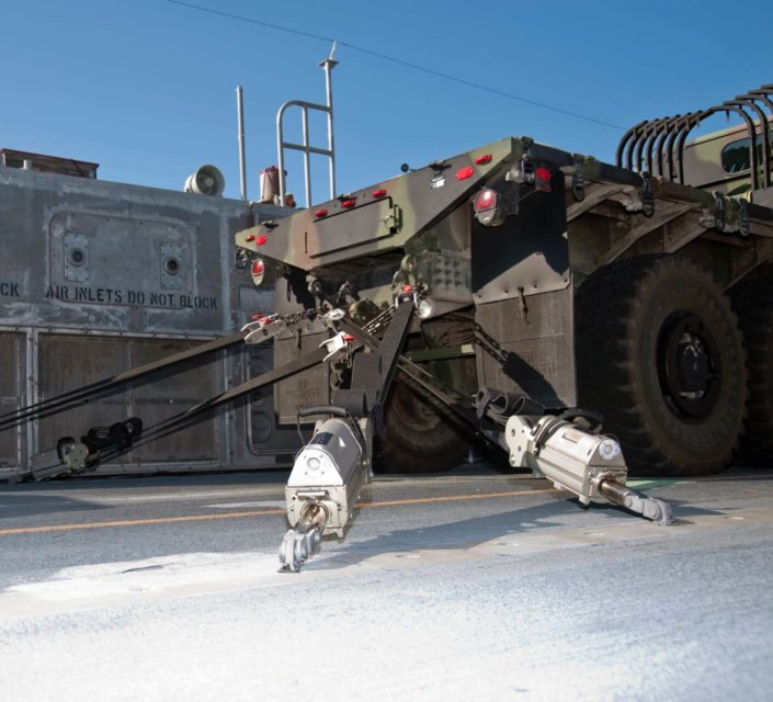 Cargo Tie-Downs being used to secure a military vehicle