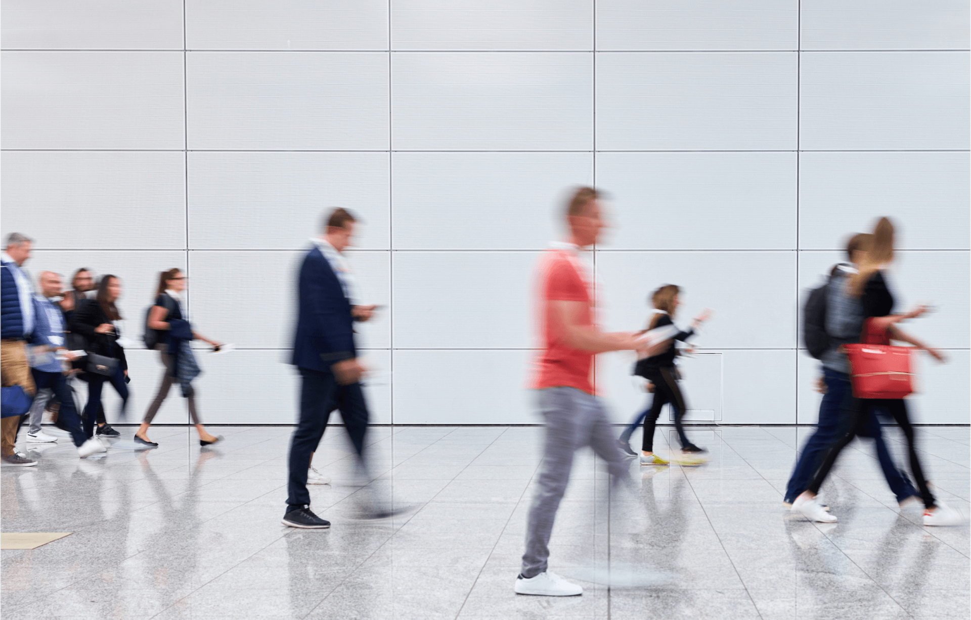 Image of groups of people walking quickly
